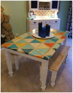DIY Triangle Pattern Kitchen Tabletop ~ Maybe not the triangles or those colours, but maybe some stripes an aqua, red, cream and brown? Homemade Kitchen Tables, Kitchen Table Makeover, Diy Kitchen, Painted Table Tops, Painted Kitchen Tables, Painted Wood, Furniture Makeover, Diy Furniture, Furniture Design