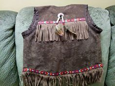 Maliseet Native youth pow wow vest . Sewn by Diana Perley , designed by Karen Miller/ Perley