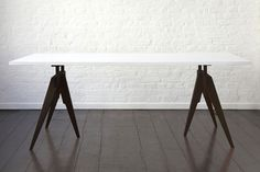 Compass table with white laminate top