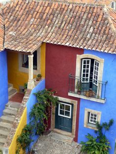 Chocolate & Blue - a typical house inside the walled town of #Obidos, Portugal
