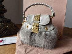 4adf7efa017b Miu Miu Micro Coffer Mini Bag Key Chain Charm in Grigio Fur and Leather -  SOLD