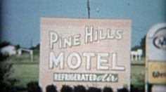 1957: Pine Hills Motel enterance sign and motor lodge with old cars. http://www.pond5.com/stock-footage/55119789?ref=StockFilm keywords:pine, hills, motel, hotel, roadside, lodge, cars, old, travel, moter inn, advisory, marking, landmark, border, trip, tourism, cliche, 1955, 1950s, 8mm, super8, 16mm, film, home movie, vintage, retro, news, tv, archive, nostalgia, memories, throwback, Americana, documentary, editorial, historic, professional, capture, grainy, preserve, restore, reality…