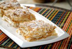 Shirini Napeloni  Puff pastry, Heavy cream, confectioner's sugar, vanilla extract