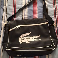 Authentic Lacoste Bag Preowned. Can be used as a laptop bag, school bag or gym bag. Lacoste Bags