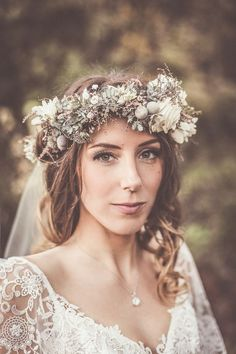 Bohemian bride with lace dress and flower crown.