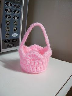 Crochet It: Free Mini Basket Crochet Pattern.  Would be a perfect size for beside a dinner plate.