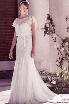 ellis bridal 2015 wedding dress vintage flutter sheer sleeves sequins embellishment tulle fluted blouson gown style 15160 / http://www.deerpearlflowers.com/wedding-dresses-with-flutter-sleeves/