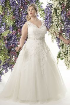 If you're a plus-size bride dreaming of a romantic lace wedding dress, look no further than the 2014 collection for Callista! See the collection here!