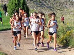 Reyes' victory leads Lady Tigers XC to first-place finish at Española. Photo by Rohm Padilla.