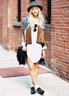 Brown jacket with a white shirtdress, studded oxfords, and sunglasses