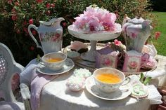 """Tea:  A round table attractively set for tea.  """"There are few hours in life more agreeable than the hour dedicated to the ceremony known as afternoon tea.""""  ---Henry James, """"The Portrait of a Lady"""""""