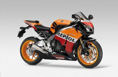 """Honda """"Repsol"""" CBR1000RR: My favorite sport bike of all time.  I am so tempted to get one, but I just can't justify the extra grand for a paint job."""