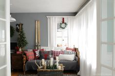 Love her rustic, ski lodge look with the cool neutrals and red plaid - so my 2015 Christmas vision.  Her walls are similar to my kitchen walls, too.  I like the drama they bring.  Also, get vintage skis from the farm!