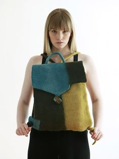 Felt is one of the world's most ancient textile techniques. It has a unique character and is created from the wool of Handmade Felt, Handmade Bags, Felt Shoes, Felt Purse, Recycled Sweaters, Latest Bags, Nuno Felting, Needle Felting, Boho Bags