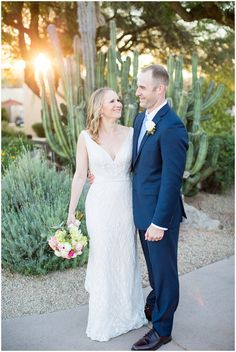 bride in essence design wedding dress holding a pink and white rose bouquet with green and groom in navy blue suit wedding portrait Charcoal Suit Wedding, Blue Suit Wedding, Wedding Men, Navy Blue Suit, Navy Suits, White Rose Bouquet, Knit Tie, Groom Style, Designer Wedding Dresses
