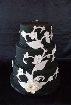 black and white cake -- flowers purple and it would be perfect