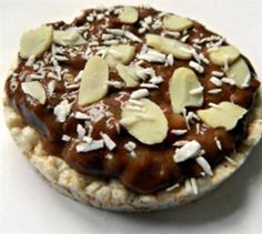 Pimp Your Rice Cake: 15 Creative Rice Cake Toppings: Rice Cake Topped with Chocolate Mashed Banana and Almonds