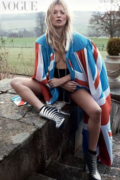 Kate Moss gets draped in the British flag with silver boots for Vogue UK