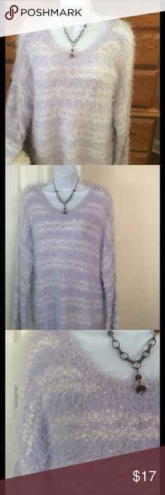 """Apt. 9 Lavender/White Soft Fuzzy Sweater NWT 54% nylon, 43 polyester and 3% other fiber.  Brand new I just cut off the main tag but the one tag is still on the sweater.   Colors are soft lavender and white.  Feels light weight . Very soft and fuzzy.  Approximately 29"""" on length and when laid flat and measured from armpit to armpit it is 27"""" across.  To me it's oversized because of its enormous stretching ability.  Long sleeve. Small embellishments add some shine. Apt. 9 Sweaters Crew & Scoop…"""