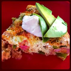 Saturday morning FRITTATA Whisked Eggs with Siracha, Pepper Bacon, Sautéed Ham, Spicy Turkey Sausage, Red and Green Bell Peppers, Scallions, Red Onion, Jalapeño, Mushrooms and Spinach, topped with Light Sour Cream and Fresh Avocado