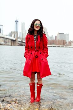 red outfit with rain boots really pop in colour but protect in style