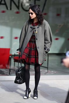 London Street Styje - Coat:  Grey Oversized Coat with Leather Straps  Dress:  Red Tartan Dress  Bag:  Black Quilted CHANEL Bag  Shoes:  Black Ankle Boots with White Toe/Heel  Photo By:  Phil Oh