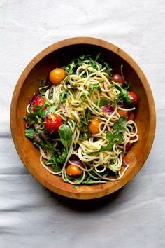 Toss short-lived garlic scapes with tomatoes and red onion in a simple pasta to capture their springtime essence.