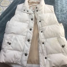 Girls Gap Puffer vest Girls size medium off white vest. Some minor stains as shown in picture...but barely noticeable, price reflects! GAP Jackets & Coats Vests