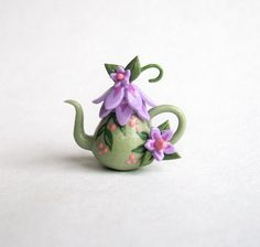 This miniature enchanting fairy blossom teapot is a one of a kind original design and creation by artist C. Rohal. It is completely hand made,