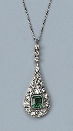 AN ART DECO EMERALD AND DIAMOND PENDANT   The pear-shaped openwork pendant set throughout with circular-cut diamonds, central step-cut emerald, on a fine chain, circa 1920, original case