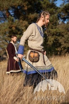 """love the colours of this tunic, but Armstreet trim always looks so totally ahistorical. Shiny, modern machine-made stuff. Pity.  Linen Ebroidered Viking Tunic """"Jarl Eric"""""""