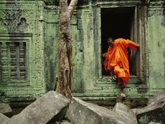 Angkor Wat Temple with Monk, Siem Reap, Cambodia By: Steve Raymer
