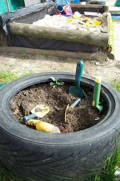 """A digging tyre at Acorns Pre-school, image shared by Niki Willows - Outside ("""",)"""