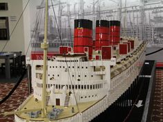 A massive LEGO model of the Queen Mary is now on display at the Queen Mary museum in Long Beach, Calif. Built by LEGO builders Bright Bricks Inc., the Queen Mary model is the largest ever of a ship made from LEGOs. Lego Cruise Ship, Lego Ship, Lego Boat, Step On A Lego, Lego Display, Underwater Animals, Lego Builder, Lego Store, Lego Trains
