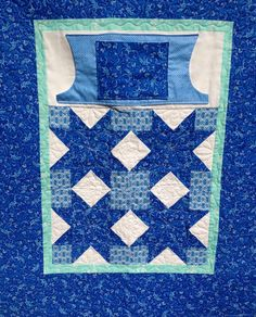 Lovie Lap Quilt with hand  warmers  and pocket -- pattern at  ... : pocket quilt pattern - Adamdwight.com