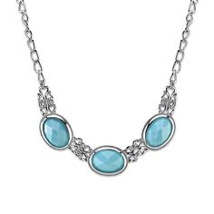 A chic and stylish collar necklace featuring turquoise color faceted oval stones in textured silver-tone settings.