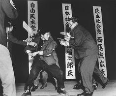 A right-wing student in Japan assassinates Inejiro Asanuma, Socialist Party Chairman, during his speech at the Hibiya Hall. (Yasushi Nagao) 1960