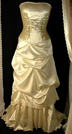 This unique corset gown uses subtle shades of ivory and taupe with delicate lace to re create a look that was inspired by edwardian bridal gowns.  This exact design is unrepeatable though a similar gown can be made.