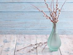 bouquet of willow branches on a wooden background