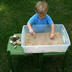 Toddler Rock Bin Activity - Count and collect rocks into pile