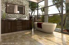 Stone wall, dark cabinetry, a modern free standing tub and outdoor views make for a natural yet sleek bathroom.