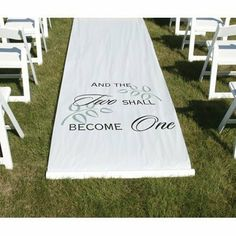"""Two Shall Become One Aisle Runner . $48.88. White fabric aisle runner features """"And The Two Shall Become One"""" design in black. Leaves are printed in grey. 36"""" x 100' long, with pull cord. Design is printed 8' from the beginning of the runner. Wording faces people as they walk down the aisle."""