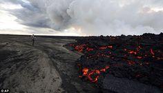 Close-up: A man stands near a lava eruption on Holuhraun near Iceland's subglacial Bardarbunga volcano