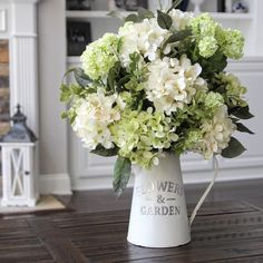 Hydrangeas in a white metal pitcher. So pretty!!!!
