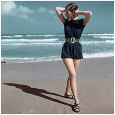 Photo Serge Balkin Model walking on beach wearing a blue swimsuit by Caroline Schnurer, 1946 Condè Nast Archive