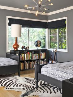"Black and white even works well in a kids' room — creating the perfect backdrop for bright toys, books and accessories. Here, designer Holly Bender of Holly Bender Interiors chose a black-and-white zebra rug to create movement in a room that boasts rich, gray walls. ""I love deep shades of gray like Benjamin Moore's Chelsea Gray. It provides a warm, yet modern, feel and really pops against white trim,"" says Bender."