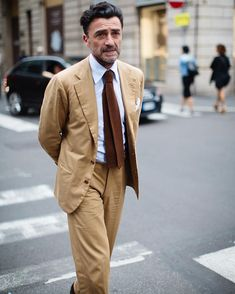Classic Italian gent dressed in the classic Italian suit walking down Via MonteNapoleone, Milan. I love the understated elegance of his look but it wouldn't be the same without that wonderful swoosh of wavy hair to add an element of youthful vigor!
