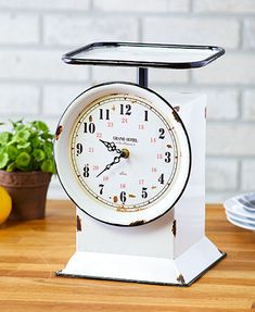 The Vintage-Inspired Grocery Scale Clock combines an antique reproduction with a modern timepiece. It looks just like the real thing, complete with a decorative weighing table on Decor, Farmhouse Decor, Farmhouse Diy, Country Decor, Vintage Home Decor, Vintage House, Vintage Scale, Farmhouse Clocks, Country Style Homes