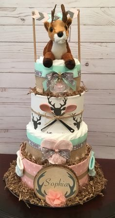 Woodland deer girl diaper cake. Coral and mint diaper cake. Visit my Facebook page Simply Showers for more pics and orders. Thanks Kim
