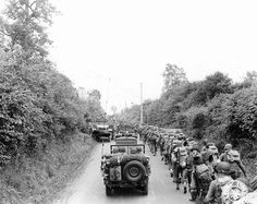 US Army soldiers and jeeps on their way to the front lines Saint-Lô France July 1944.